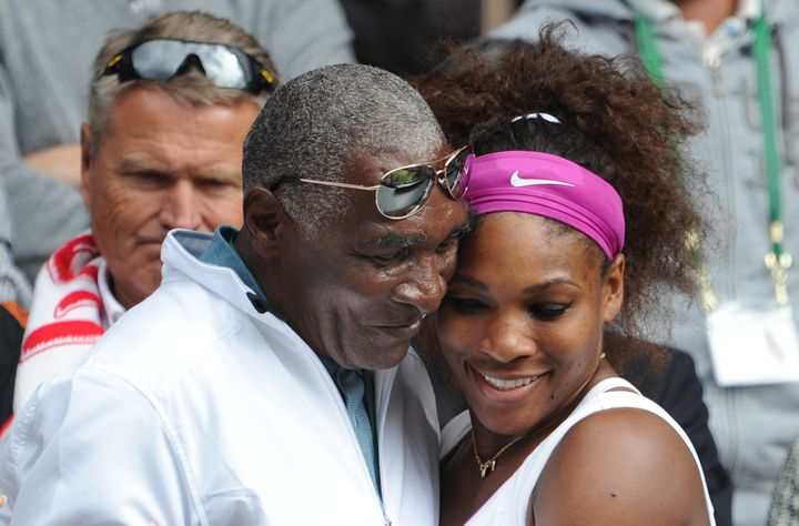 Serena Williams hugs her father, Richard Williams, after winning her Ladies Singles Final match at the 2012 Wimbledon Te