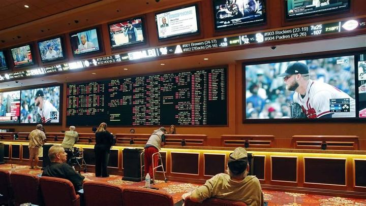 People make bets in the sports book at the South Point hotel and casino in Las Vegas. The U.S. Supreme Court has cleared the