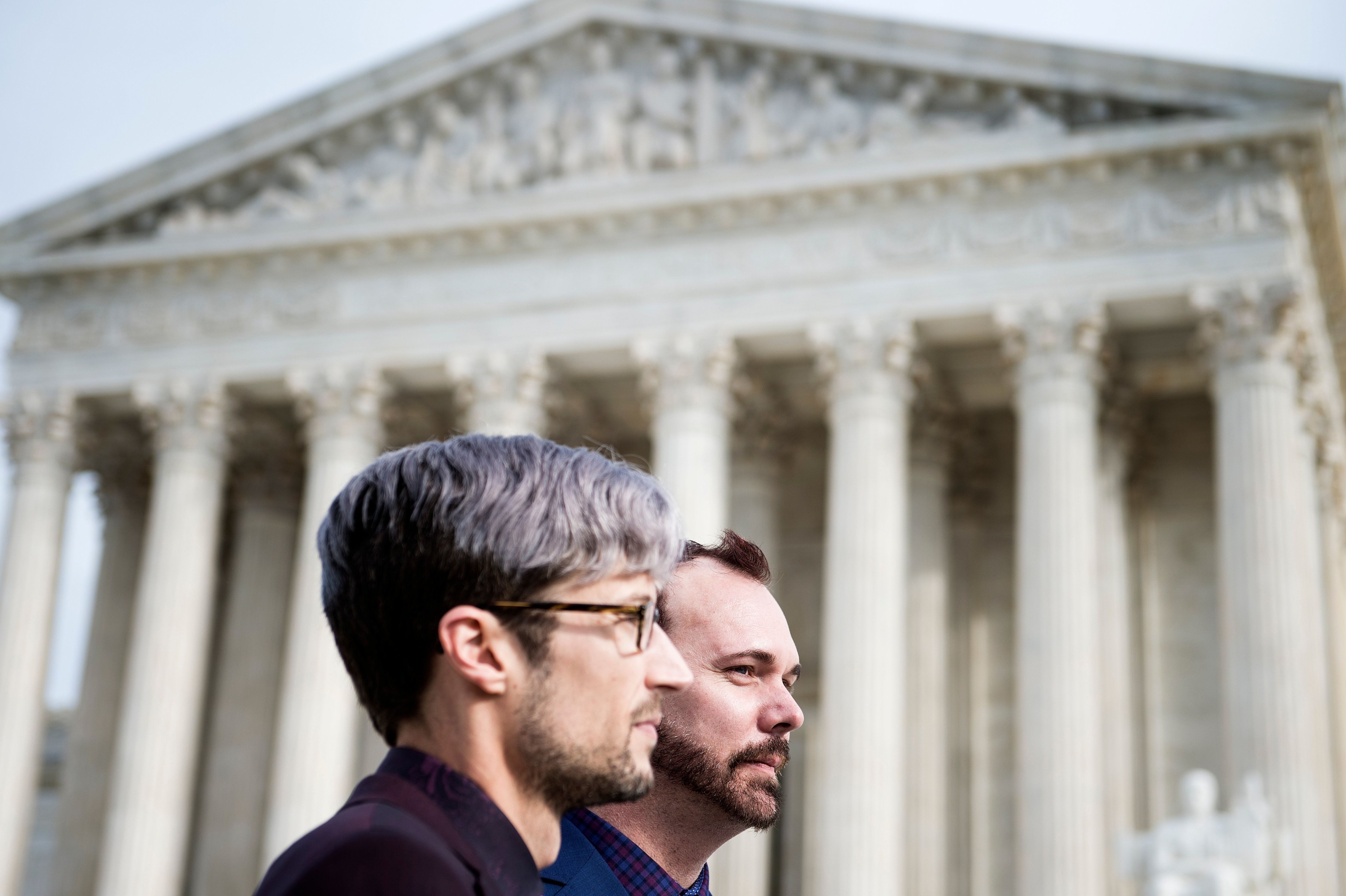 Dave Mullins (L) and his spouse Charlie Craig stand outside the US Supreme Court after Masterpiece Cakeshop vs. Colorado Civil Rights Commission is heard on December 5, 2017 in Washington, DC. The US Supreme Court is to hear arguments on Tuesday in a case that has been described as the most significant for gay rights since it approved same-sex marriage two years ago. The landmark case pits a gay couple, Dave Mullins and Charlie Craig, against a Colorado bakery owner who refused in July 2012 to make a cake for their same-sex wedding reception.  / AFP PHOTO / Brendan Smialowski        (Photo credit should read BRENDAN SMIALOWSKI/AFP/Getty Images)