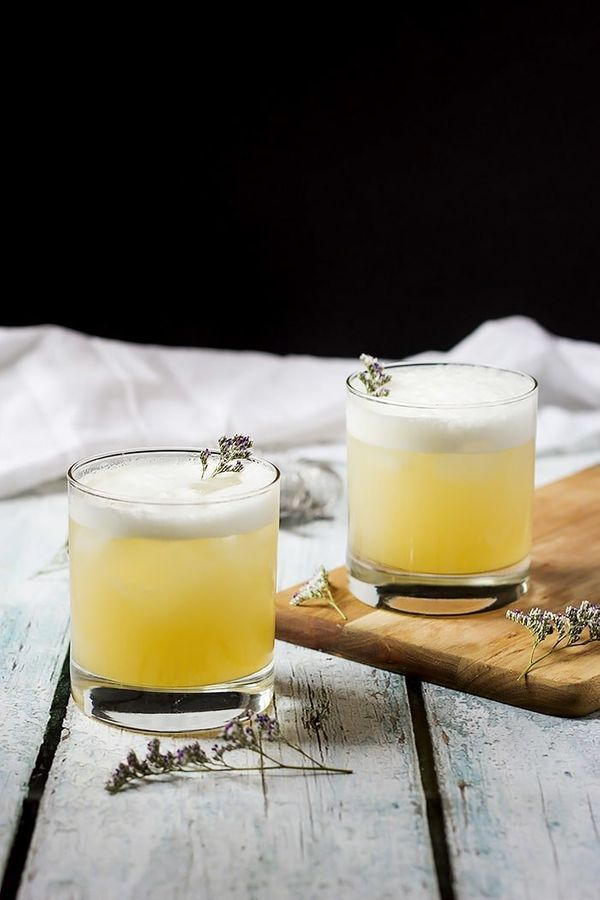 """<strong>Get the<a href=""""https://www.cookswithcocktails.com/elderflower-peach-and-lavender-gin-sour/"""" target=""""_blank"""">El"""