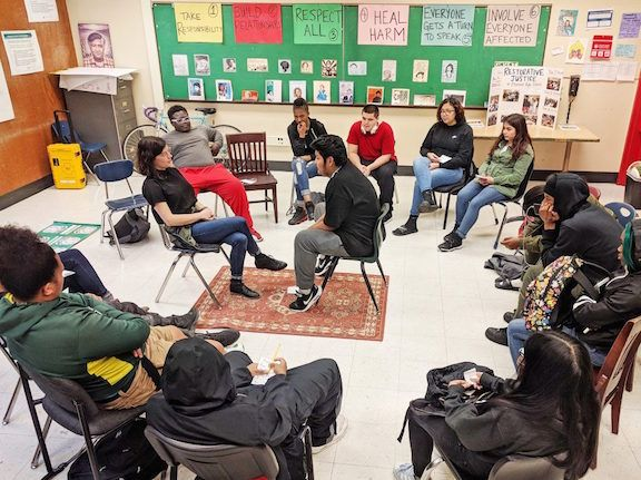 A community building circle in Tatiana Chaterji's classroom at Fremont High School in the Oakland Unified School District