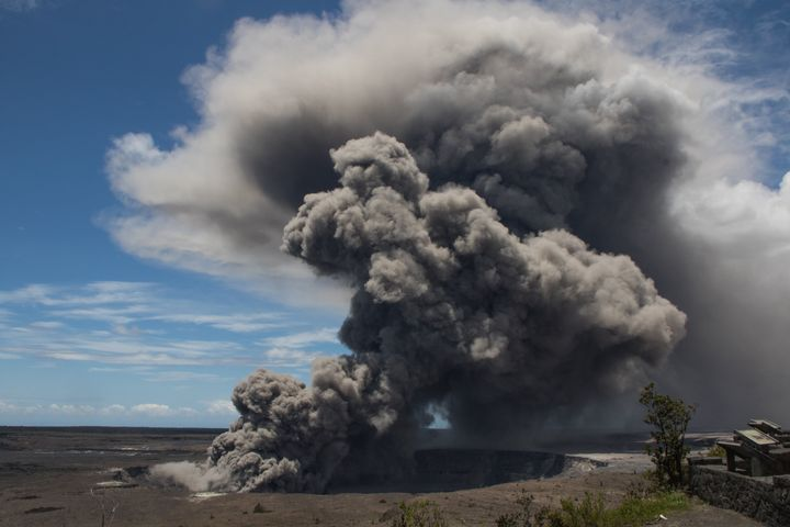The ash plume billows upward from Kilauea.