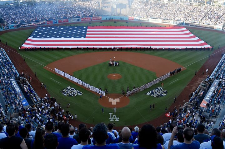 People stand in Los Angeles' Dodger Stadium during the national anthem before Game 1 of the 2017 World Series.