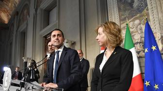 Anti-establishment Five Star Movement (M5S) leader Luigi Di Maio (C) flanked by Danilo Toninelli (L) president of the M5S group at the Senate and Giulia Grillo, president of the M5S group at the Parliament, speaks to the press after a meeting with Italian President Sergio Mattarella as part of consultations of political parties to form a government, on May 14, 2018 at the Quirinale palace in Rome. - The leaders of the anti-immigrant League party and anti-establishment Five Star Movement meet the Italian president today to share details of a coalition government programme three month after general elections in Italy. (Photo by ANDREAS SOLARO / AFP)        (Photo credit should read ANDREAS SOLARO/AFP/Getty Images)
