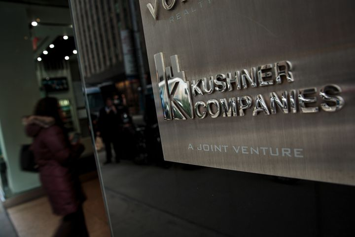 The Kushner Companies logo near the entrance to 666 Fifth Avenue.