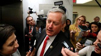 U.S. Representative Mark Meadows (R-NC) (C) is trailed by reporters as he walks between meetings at the U.S. Capitol in Washington, U.S. January 18, 2018.  REUTERS/Jonathan Ernst