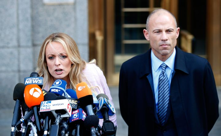 Adult film actress Stephanie Clifford, also known as Stormy Daniels, speaks to media along with lawyer Michael Avenatti in Ma