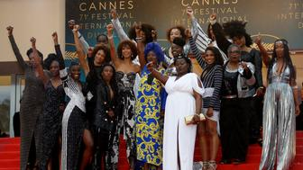 "71st Cannes Film Festival - Screening of the film ""Burning"" (Beoning) in competition - Red Carpet Arrivals - Cannes, France May 16, 2018. French actresses Nadege Beausson-Diagne, Mata Gabin, Maimouna Gueye, Eye Haidara, Rachel Khan, Aissa Maiga, Sara Martins, Marie-Philomene Nga, Sabine Pakora, Firmine Richard, Sonia Rolland, Magaajyia Silberfeld, Shirley Souagnon, Assa Sylla, Karidja Toure, who collaborated for the publication of the book ""Noire n'est pas mon metier"" (Black is not my job) pose. REUTERS/Eric Gaillard"