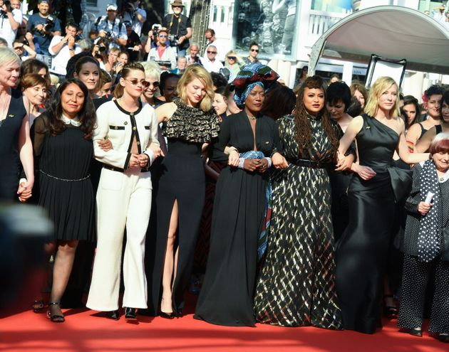 On Saturday, 82 women, including director Ava DuVernay and actress Cate Blanchett, linked arms to protest...