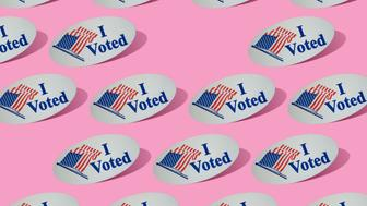 Rows of I Voted flag stickers on a pink background