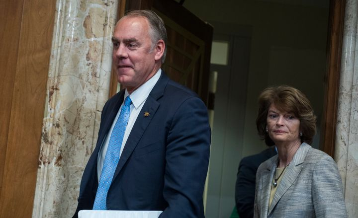 Interior Secretary Ryan Zinke and Sen. Lisa Murkowski (R-Alaska) arrive for a Senate hearing in May.