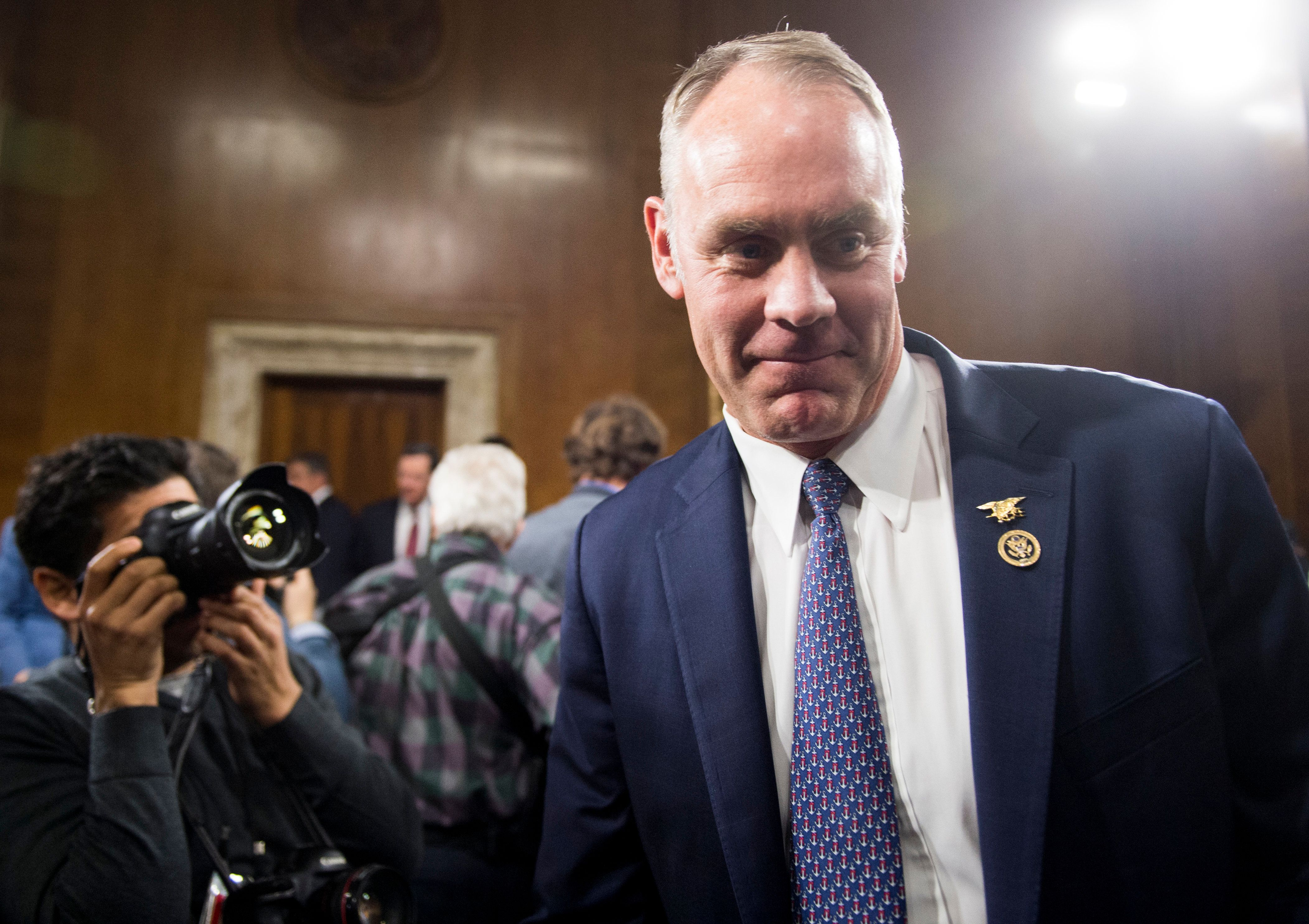 UNITED STATES - JANUARY 17: Secretary of the Interior nominee Rep. Ryan Zinke, R-Mont., returns to his seat after greeting chairwoman Sen. Lisa Murkowski, R-Alaska, before the start of his confirmation hearing in the Senate Energy and Natural Resources Committee on Tuesday, Jan. 17, 2017. (Photo By Bill Clark/CQ Roll Call)