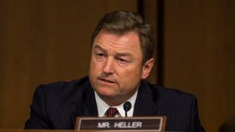 WASHINGTON, DC - APRIL 10:  U.S. Sen. Dean Heller (R-NV) asks questions as Facebook co-founder, Chairman and CEO Mark Zuckerberg testifies before a combined Senate Judiciary and Commerce committee hearing in the Hart Senate Office Building on Capitol Hill April 10, 2018 in Washington, DC. Zuckerberg, 33, was called to testify after it was reported that 87 million Facebook users had their personal information harvested by Cambridge Analytica, a British political consulting firm linked to the Trump campaign. Photo by Zach Gibson/Getty Images)