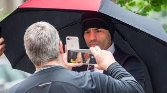 Aaron Schlossberg faces down reporters and an angry public