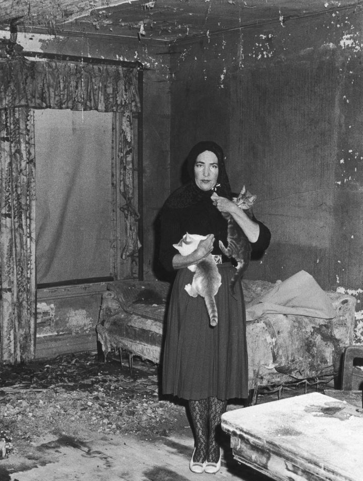 """Little Edie"" and two of her cats, at Grey Gardens circa 1973."