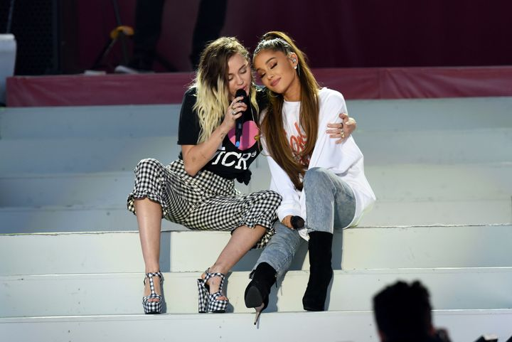 Miley Cyrus and Ariana Grande perform on stage during 'One Love Manchester' benefit concert.