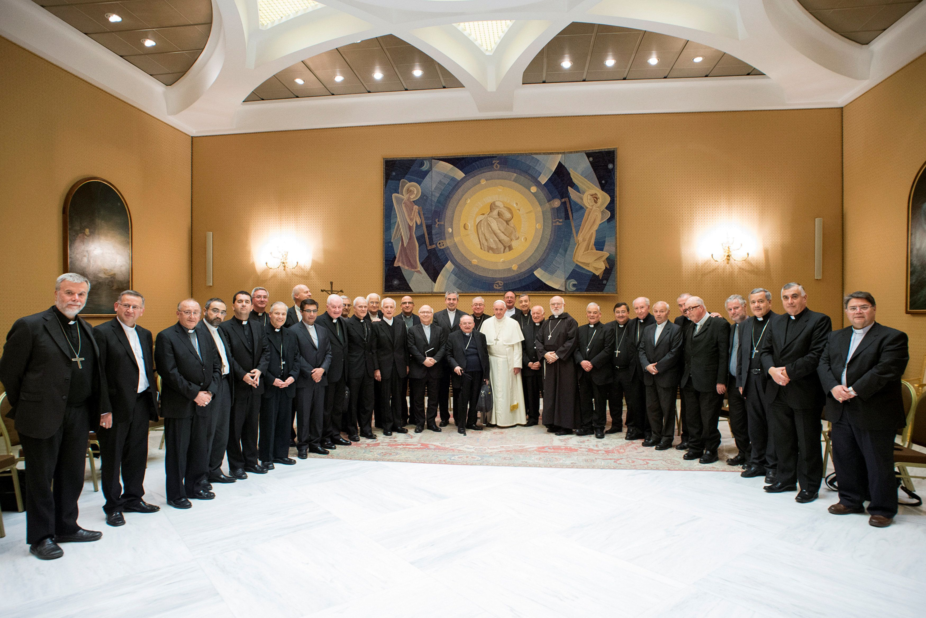 Pope Francis poses with Chilean bishops after a meeting at the Vatican on May 17.