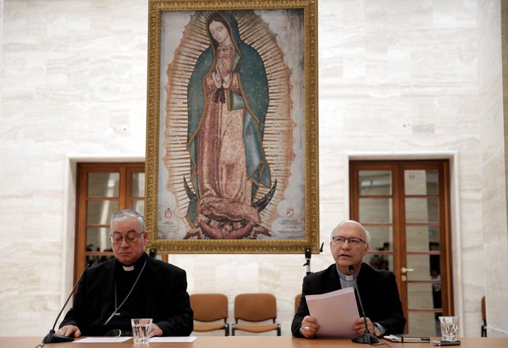 Chilean bishops Luis Fernando Ramos Perez and Juan Ignacio Gonzalez Errazuriz read statements during a news conference after
