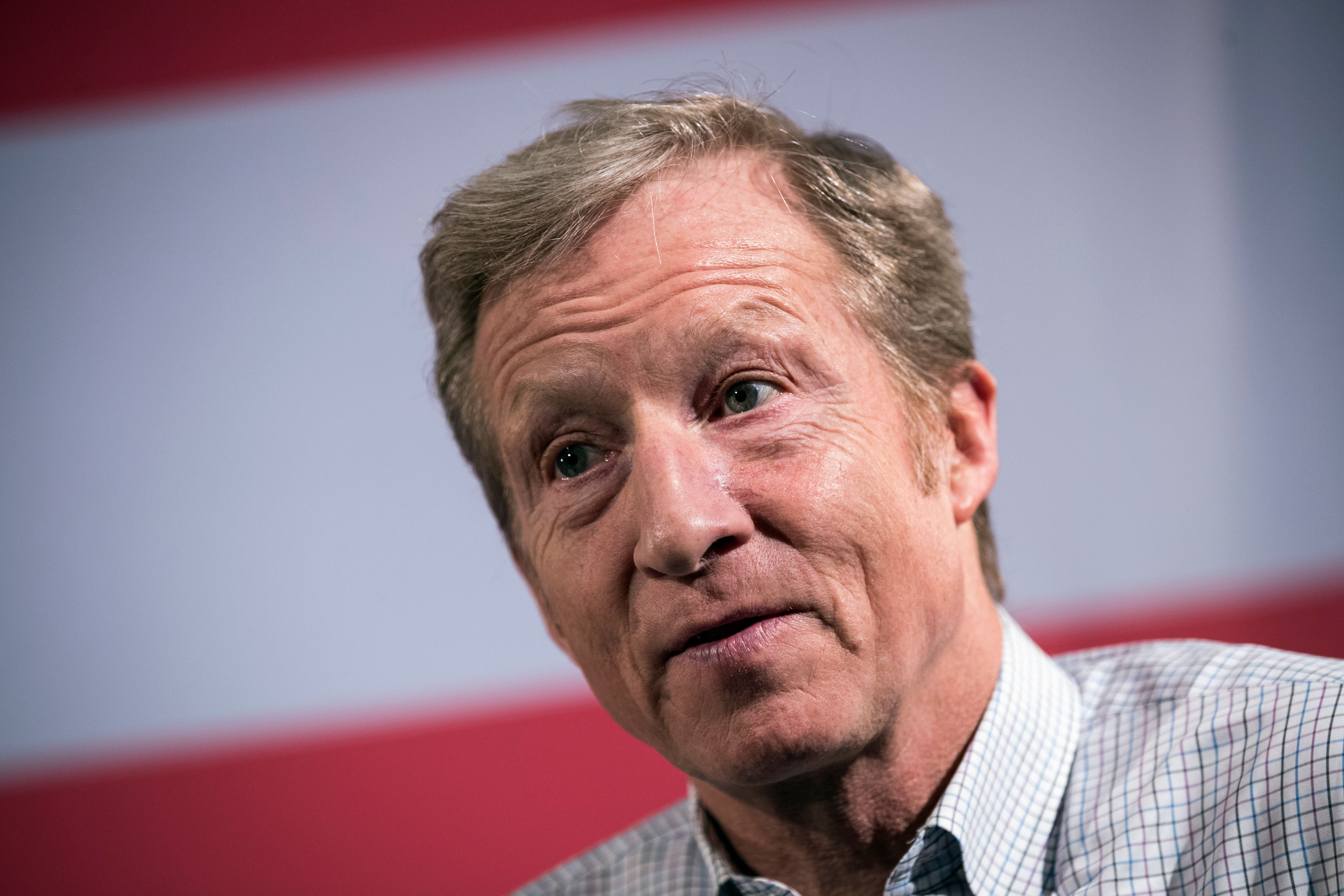 NEW YORK, NY - JANUARY 29: Hedge fund billionaire and Democratic fund-raiser Tom Steyer speaks during a town hall event at the DoubleTree Suites by Hilton hotel in Times Square January 29, 2018 in New York City. Steyer is the founder of the Need To Impeach initiative and is the largest individual donor in Democratic politics. (Photo by Drew Angerer/Getty Images)