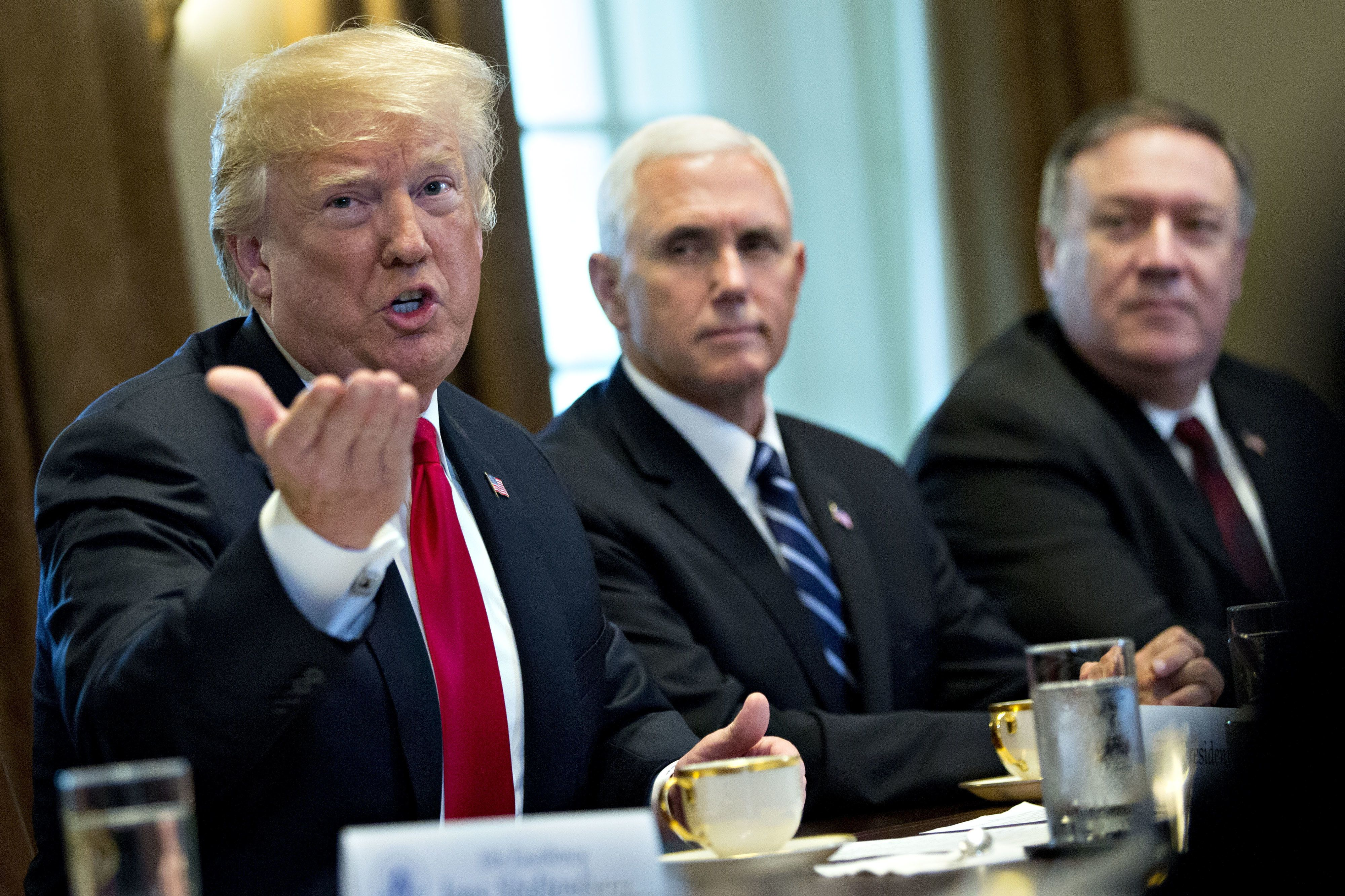U.S. President Donald Trump speaks as U.S. Vice President Mike Pence, center, and Mike Pompeo, U.S. secretary of state, listen during a meeting with Jens Stoltenberg, secretary general of the North Atlantic Treaty Organization (NATO), not pictured, in the Cabinet Room of the White House in Washington, D.C. U.S., on Thursday, May 17, 2018. The White House said the two leaders will be discussing the upcoming NATO Summit in July. Photographer: Andrew Harrer/Bloomberg via Getty Images