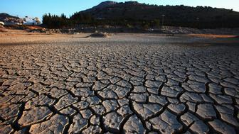 RHODES, GREECE - JULY 16:  Dry out ground near rodes city on July 16, 2009 in Rhodes, Greece. Rhodes is the largest of the Greek Dodecanes Islands. Due to climate change and global warming many areas and rivers drying out. (Photo by EyesWideOpen/Getty Images)