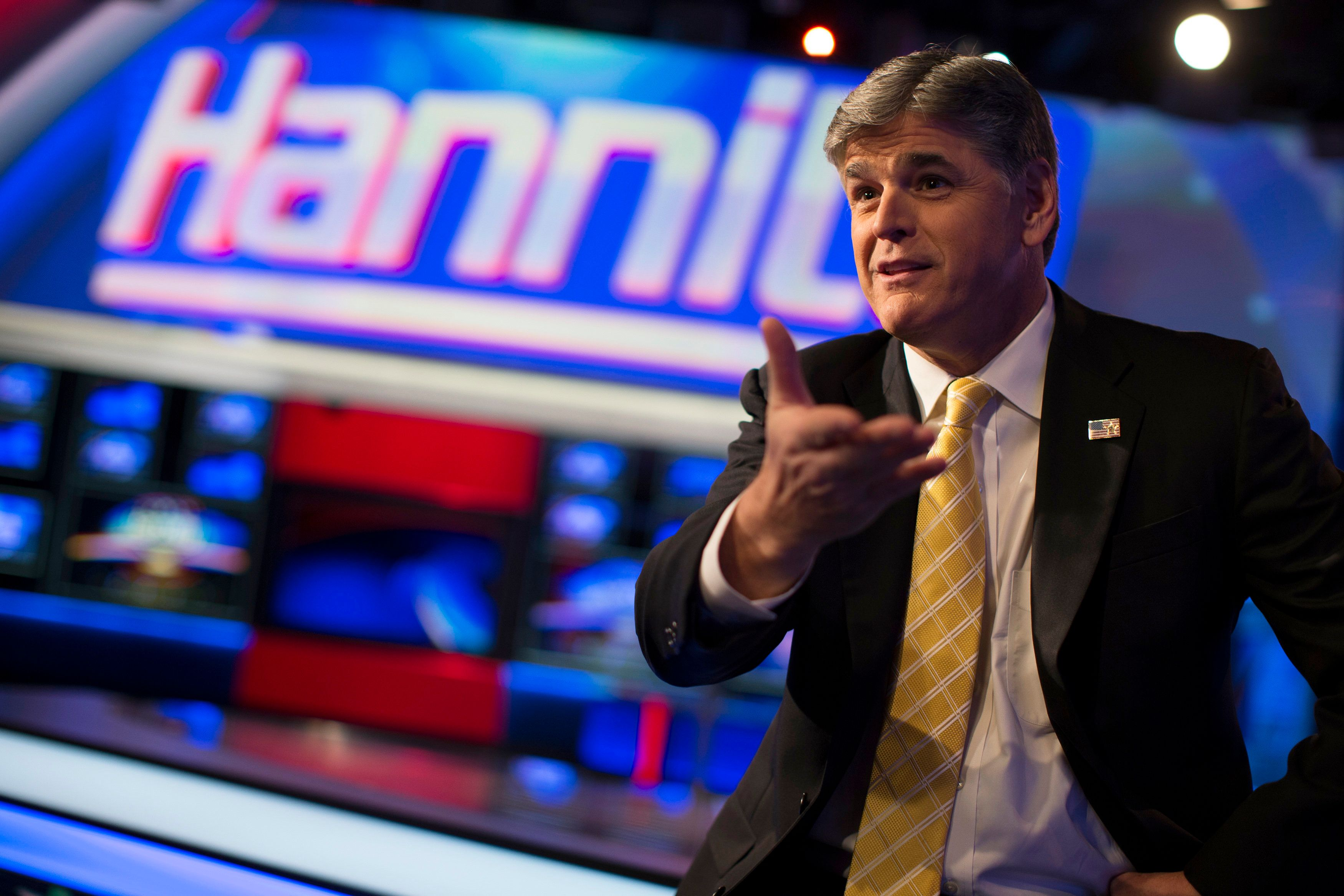 """Fox News Channel anchor Sean Hannity poses for photographs as he sits on the set of his show """"Hannity"""" at the Fox News Channel's studios in New York City, October 28, 2014.  REUTERS/Mike Segar   (UNITED STATES - Tags: MEDIA POLITICS ENTERTAINMENT)"""