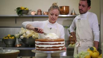 LONDON, ENGLAND - MAY 17: (ONLINE OUT) Claire Ptak, Owner of Violet Bakery in Hackney, east London and head baker Izaak Adams put finishing touches on the cake for the Royal Wedding of Prince Harry and Meghan Markle in the kitchens at Buckingham Palace on May 17, 2018 in London England. (Photo by Hannah McKay - WPA Pool /Geetty Images)