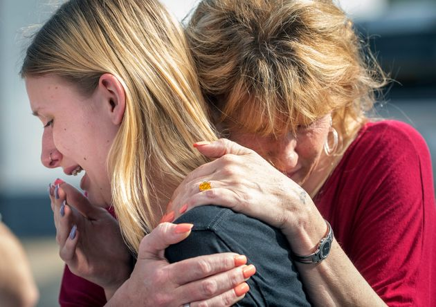 Santa Fe High School student Dakota Shrader is comforted by her mother Susan Davidson following the shooting...