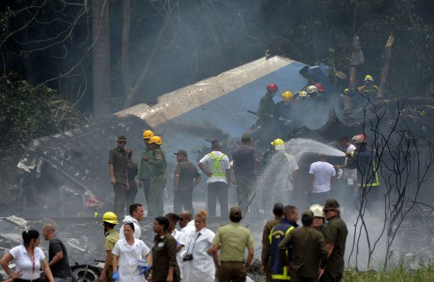 Emergency personnel work at the site of a plane crash outside Havana's Jose Marti International Airport...