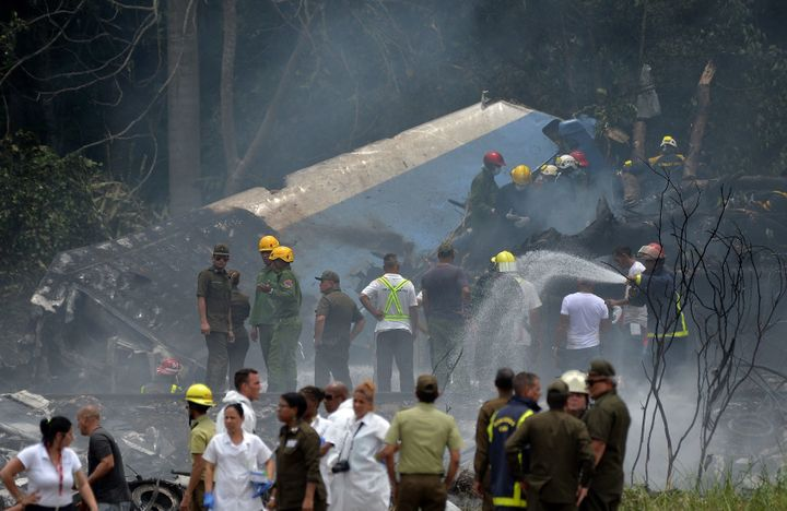 Emergency personnel work at the site of a planecrash outside Havana's Jose Marti International Airport onFr