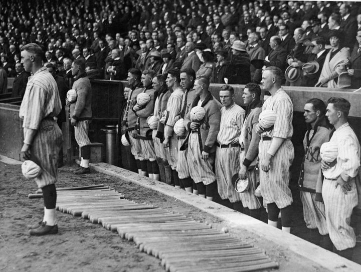 The New York Yankees hold their caps over their hearts during the national anthem in 1921.