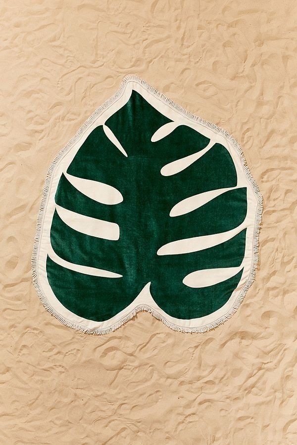 "Get it on <a href=""https://www.urbanoutfitters.com/shop/bando-monstera-leaf-oversized-beach-towel"" target=""_blank"">Urban Outf"
