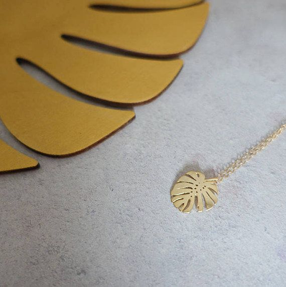 "Get it on <a href=""https://www.etsy.com/listing/556753174/gold-monstera-leaf-charm-necklace-gold"" target=""_blank"">Etsy</a>, $"