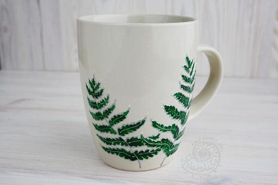 "Get it on <a href=""https://www.etsy.com/listing/538237918/green-fern-hand-painted-mug-plant-gift"" target=""_blank"">Etsy</a>, $"