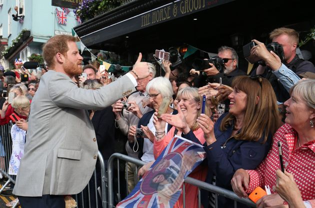 Prince Harry meet members of the public outside Windsor Castle ahead of his wedding to Meghan Markle...