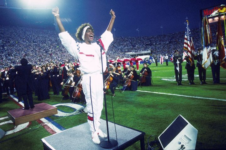 Whitney Houston sings the national anthem during the pregame show at Super Bowl XXV in 1991.