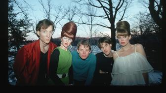 The members of the new wave band the B-52s pose outdoors in front of a lake. From left to right: Fred Schneider (vocals), Kate Pierson (vocals and keyboards), Ricky Wilson (guitar), Keith Strickland (drums), and Cindy Wilson (vocals and guitar).   (Photo by Lynn Goldsmith/Corbis/VCG via Getty Images)