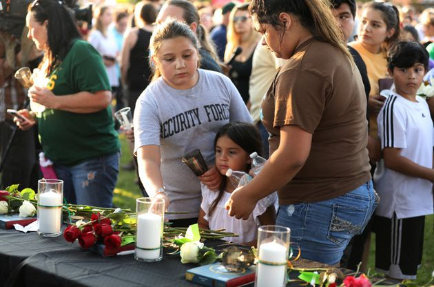Community members honor the victims of Friday's mass shooting at Santa Fe High School in