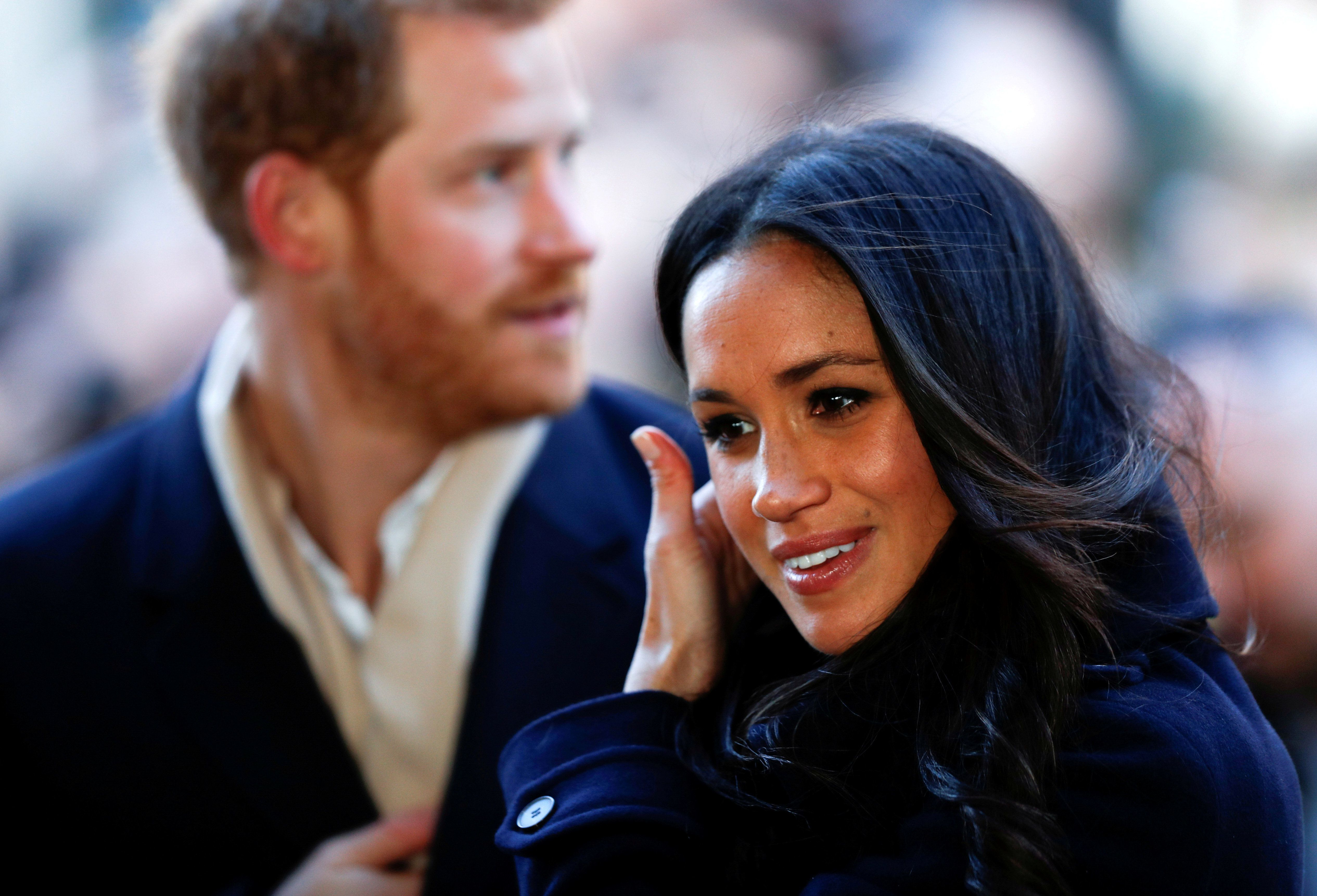 Britain's Prince Harry and his fiancee Meghan Markle arrive at an event in Nottingham, Britain, December 1, 2017. REUTERS/Adrian Dennis/Pool     TPX IMAGES OF THE DAY