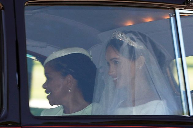 The bride was seated next to her mother, Doria