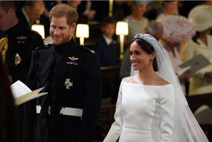 """Príncipe Harry y Meghan Markle adentro de St. George's Chapel en el Castillo de Windsor el día de su boda. """"Ufano ="""" 720 """"cumbre ="""" 481 """"/> </div> <p> <span aria-hidden="""