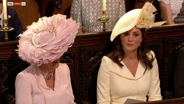 The Duchess of Cambridge (right) appears to suppress a little laugh while sitting next to the Duchess...