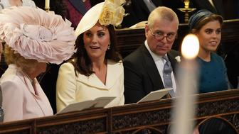 (L-R) Britain's Camilla, Duchess of Cornwall, Britain's Catherine, Duchess of Cambridge, Britain's Prince Andrew, Duke of York and Britain's Princess Beatrice of York wait in the chapel ahead of the wedding ceremony of Britain's Prince Harry, Duke of Sussex and US actress Meghan Markle in St George's Chapel, Windsor Castle, in Windsor, on May 19, 2018. (Photo by Jonathan Brady / POOL / AFP)        (Photo credit should read JONATHAN BRADY/AFP/Getty Images)