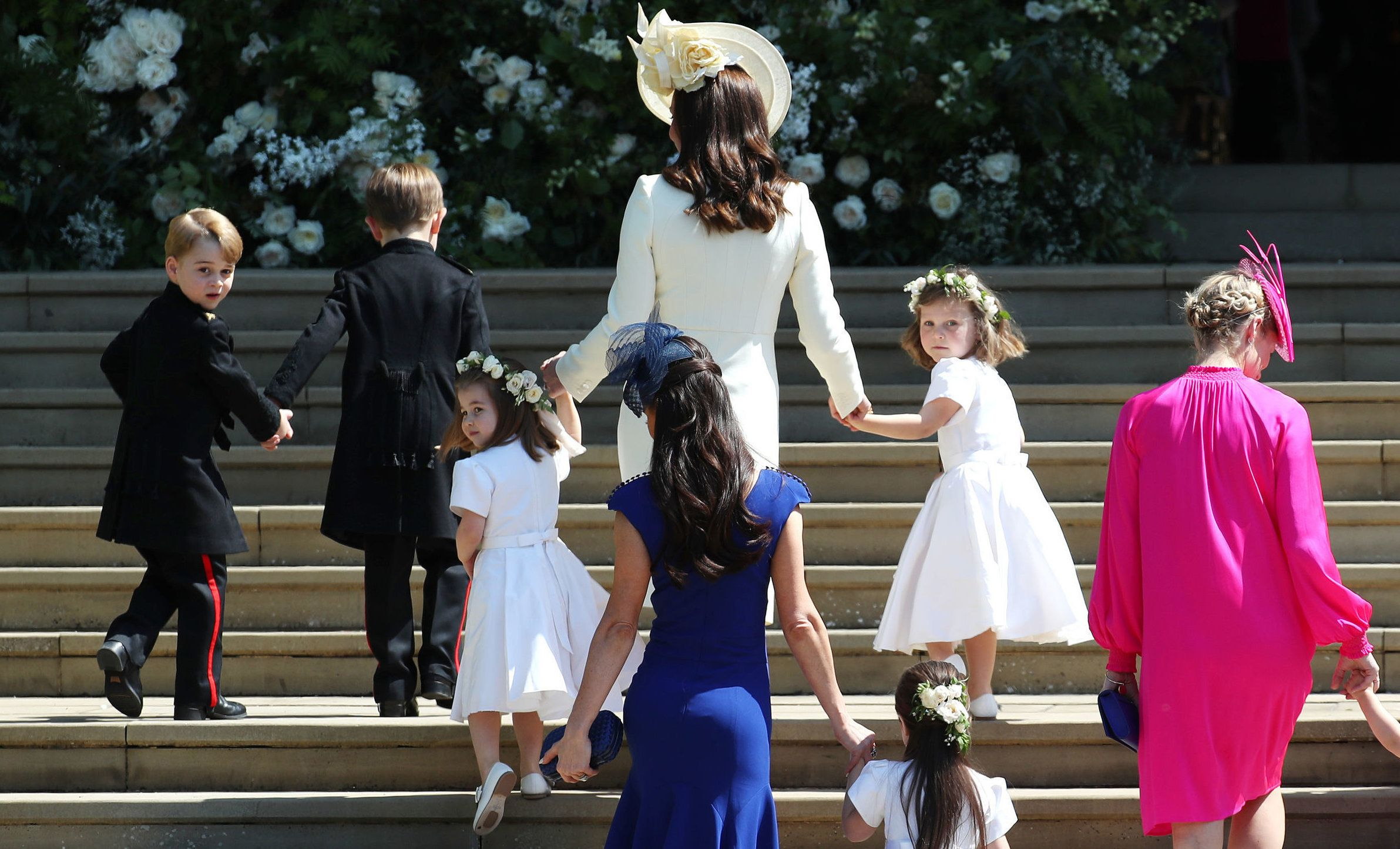 Britain's Catherine, Duchess of Cambridge (C) walks up the west steps with Prince George (L) and bridesmaids for the wedding ceremony of Britain's Prince Harry, Duke of Sussex and US actress Meghan Markle at St George's Chapel, Windsor Castle, in Windsor, on May 19, 2018. (Photo by Jane Barlow / POOL / AFP)        (Photo credit should read JANE BARLOW/AFP/Getty Images)