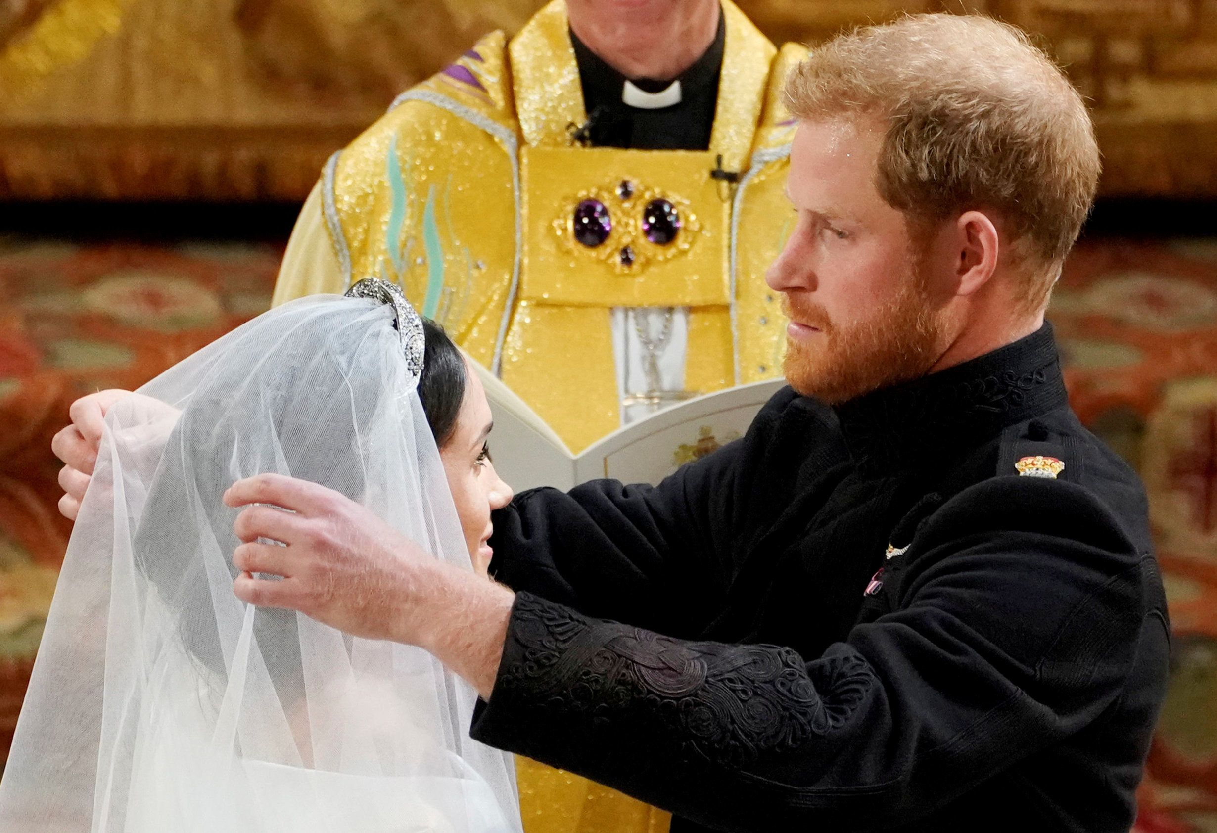 Prince Harry and Meghan Markle in St George's Chapel at Windsor Castle during their wedding service, conducted by the Archbishop of Canterbury Justin Welby in Windsor, Britain, May 19, 2018. Owen Humphreys/Pool via REUTERS     TPX IMAGES OF THE DAY