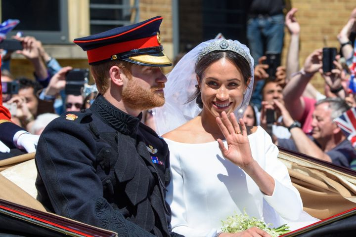 Prince Harry and Meghan Markle, the new Duke and Duchess of Sussex, pictured during their carriage procession through Windsor after the royal wedding on Saturday.