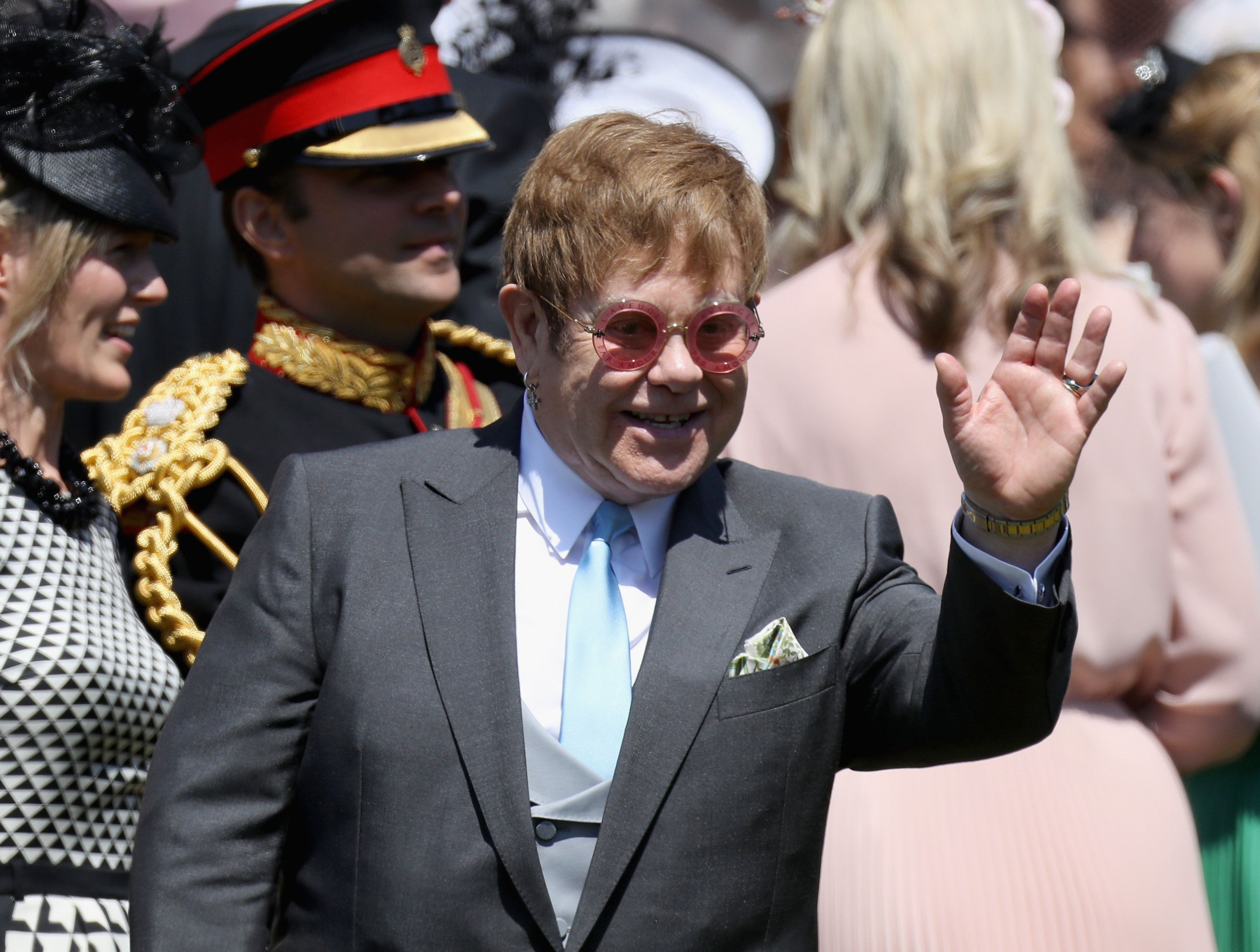 WINDSOR, ENGLAND - MAY 19:  Sir Elton John arrives at the wedding of Prince Harry to Ms Meghan Markle at St George's Chapel, Windsor Castle on May 19, 2018 in Windsor, England. Prince Henry Charles Albert David of Wales marries Ms. Meghan Markle in a service at St George's Chapel inside the grounds of Windsor Castle. Among the guests were 2200 members of the public, the royal family and Ms. Markle's Mother Doria Ragland.  (Photo by Chris Jackson/Getty Images)