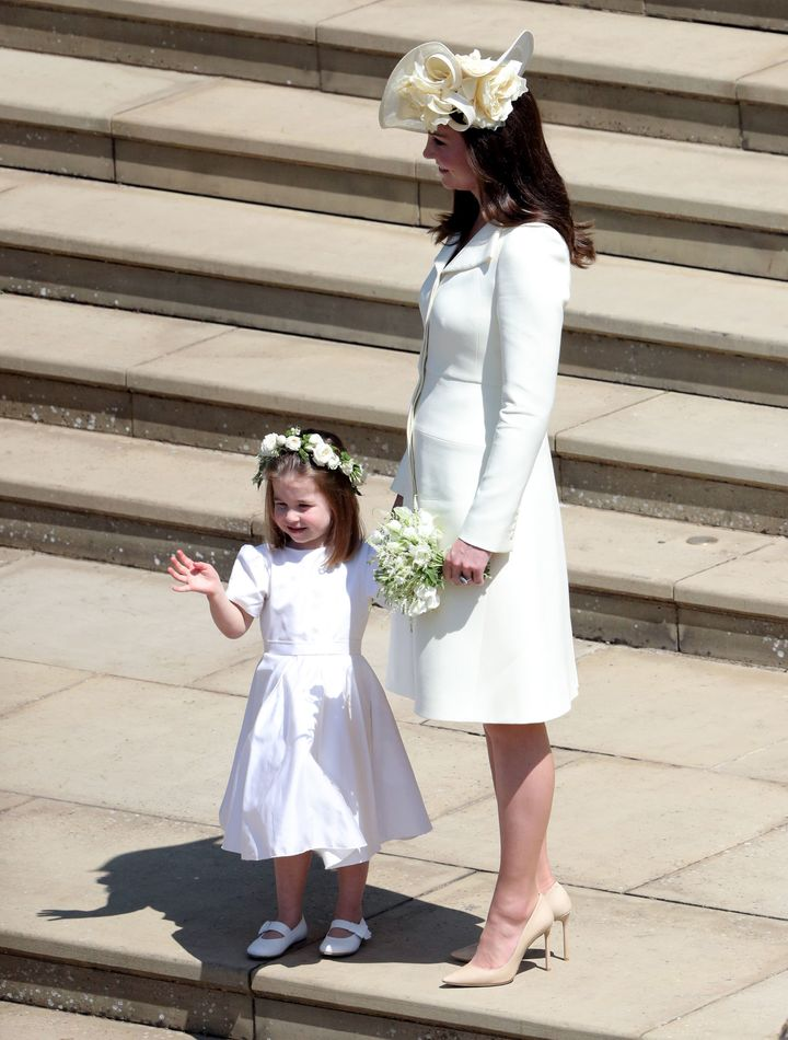 Princess Charlotte holding the hand of her mother, the Duchess of Cambridge.