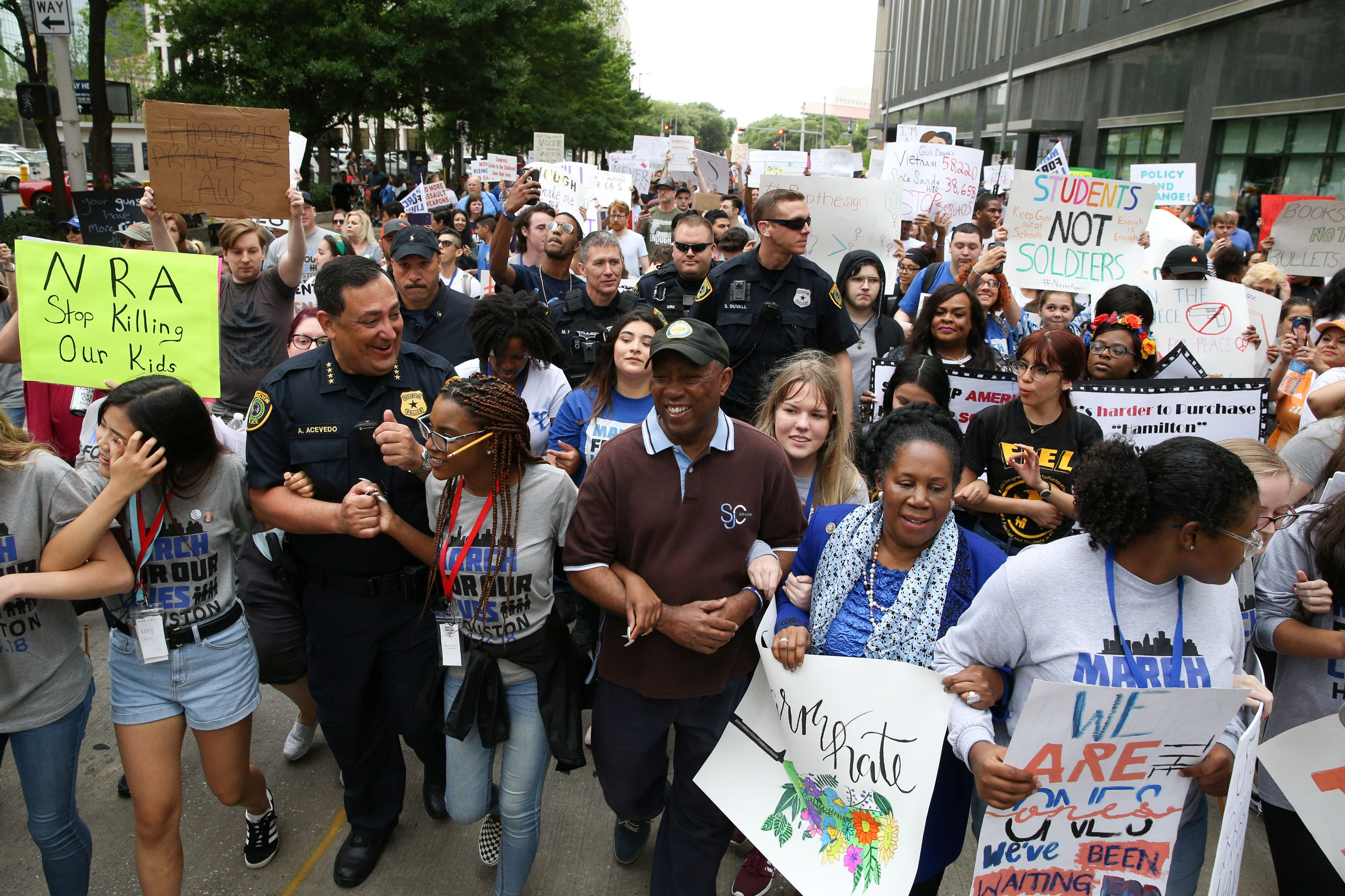 """Houston Police Chief Art Acevedo, Houston Mayor Sylvester Turner, U.S. Rep. Sheila Jackson Lee and student organizers lead the """"March for Our Lives"""", an organized demonstration to end gun violence, in downtown Houston, Texas, U.S., March 24, 2018.  REUTERS/Loren Elliott"""