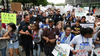 "Houston Police Chief Art Acevedo, Houston Mayor Sylvester Turner, U.S. Rep. Sheila Jackson Lee and student organizers lead the ""March for Our Lives"", an organized demonstration to end gun violence, in downtown Houston, Texas, U.S., March 24, 2018.  REUTERS/Loren Elliott"